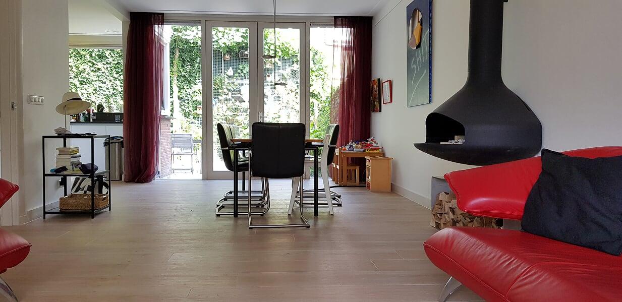 Verbouwing UFA Bouw_Schiedam_huiskamer overzicht naar tuin