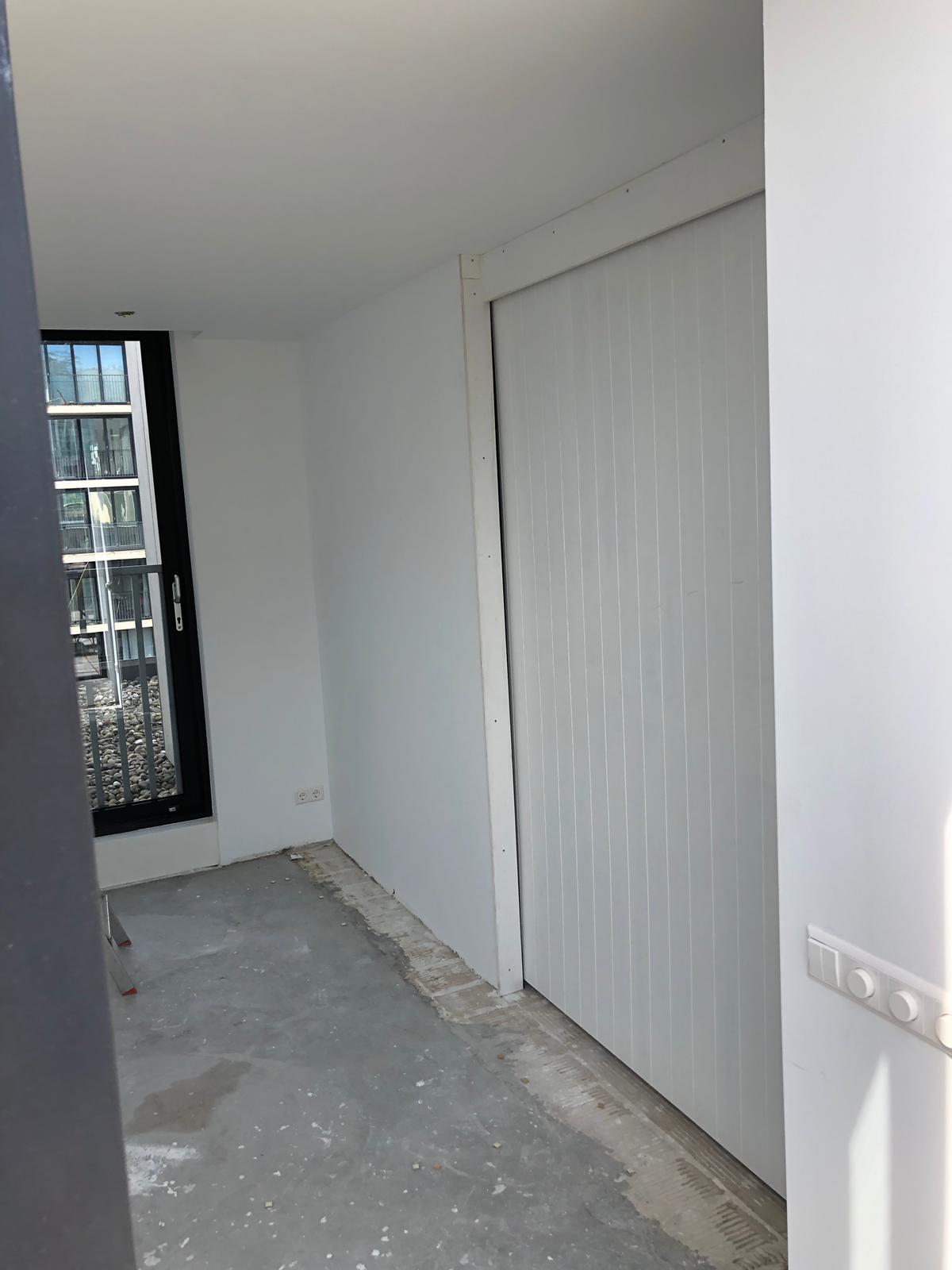 UFA Bouw_Dakuitbouw Westerdoksdijk_Dakopbouw interieur schuifdeur 2