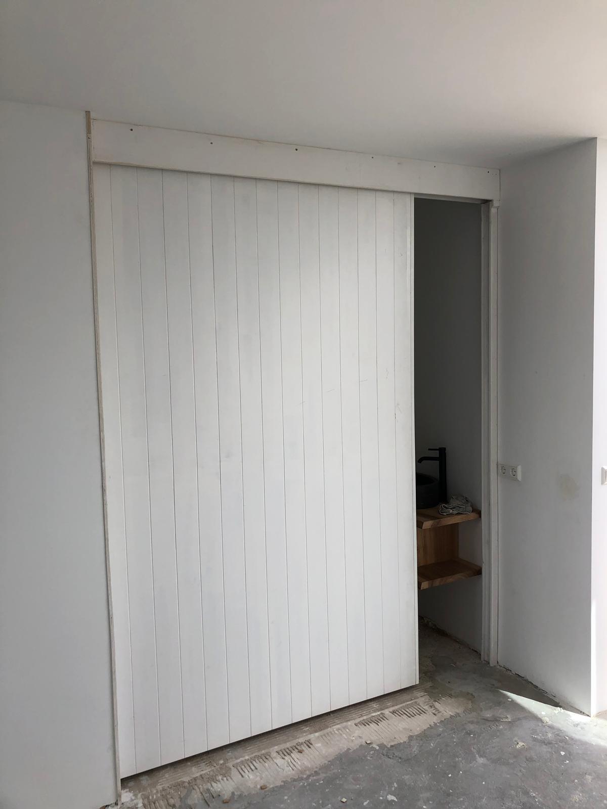 UFA Bouw_Dakuitbouw Westerdoksdijk_Dakopbouw interieur schuifdeur 3