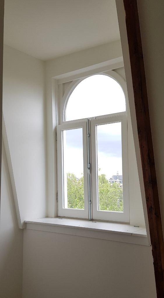 UFA Bouw_Renovatie_Nassaulaan 37_zolder appartement raam_563x1024